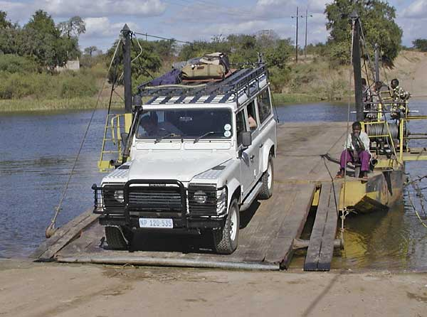 Crossing ferry in Africa in Land Rover Defender